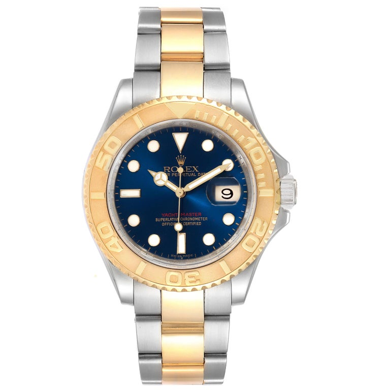 Rolex Yachtmaster 40mm Steel Yellow Gold Blue Dial Mens Watch 16623. Officially certified chronometer self-winding movement. Stainless steel case 40.0 mm in diameter. Rolex logo on a crown. 18k yellow gold special time-lapse unidirectional rotating