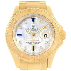 Rolex Yachtmaster Yellow Gold Mother of Pearl Diamond Sapphire Serti Watch 16628