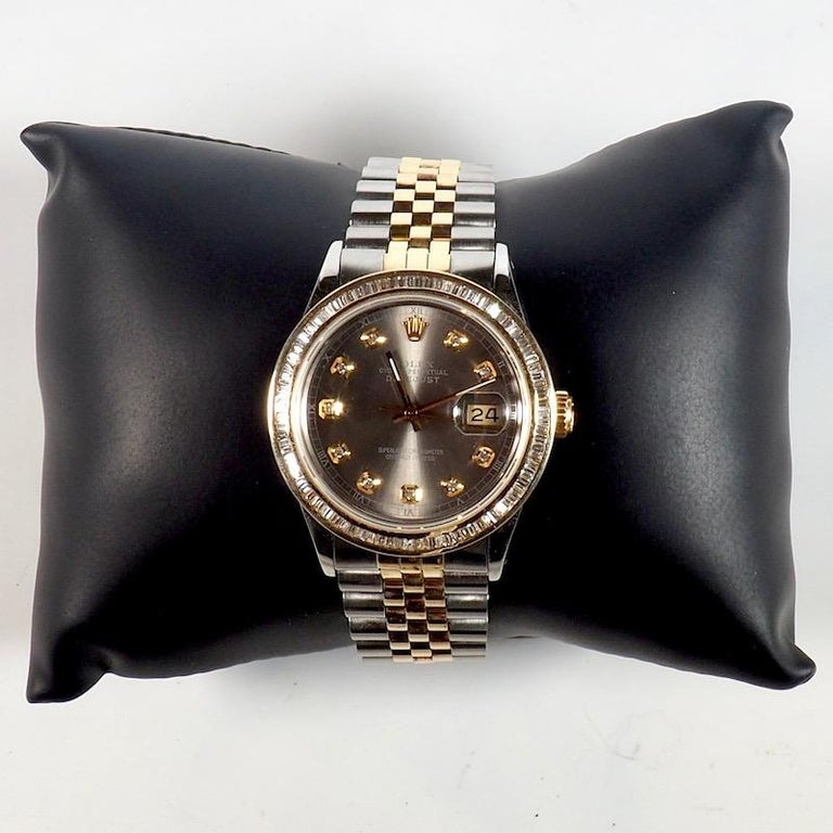 Rolex yellow gold and stainless steel oyster perpetual Datejust 36mm Wristwatch with a jubilee bracelet and custom diamond bezel. A wonderful solid gold customised Rolex of exceptional quality and condition set with baguette cut diamonds.  Technical