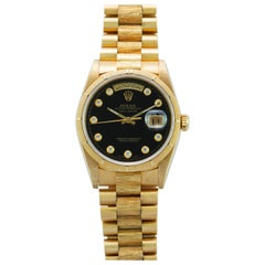 Rolex Yellow Gold Day-Date Black Onyx Serti Dial President Watch, Box and Papers