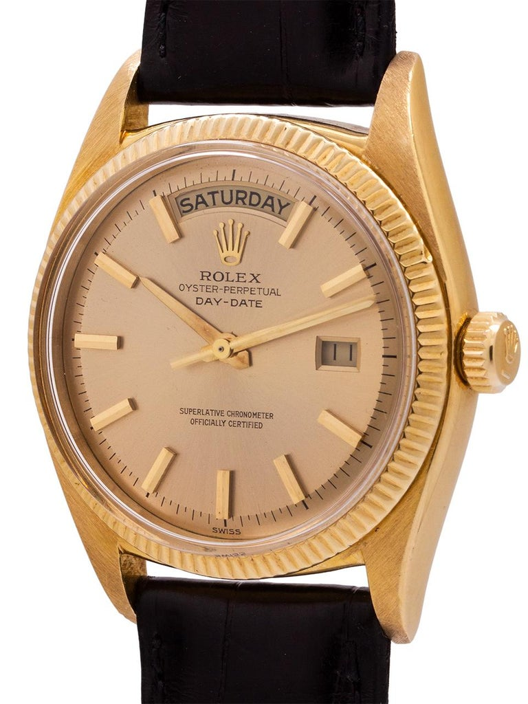 Rare and fabulous vintage Rolex 18K YG ref 6611B Day Date model circa 1959. Man's full size 36mm diameter case with 18K YG fine fluted bezel, with acrylic crystal, sans cyclops magnifier. Very pleasing original champagne dial with applied stick