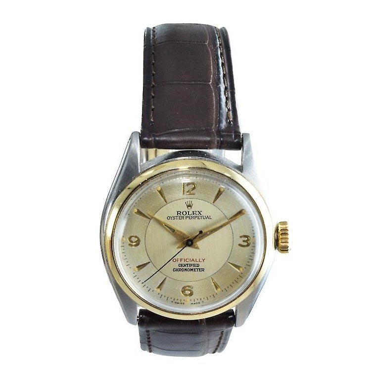 FACTORY / HOUSE: Rolex Watch Company STYLE / REFERENCE: Oyster Perpetual / Ref. 6084 METAL / MATERIAL: Two Tone / 14Kt. & Stainless Steel  DIMENSIONS:  39mm  X  34mm CIRCA: 1950/51 MOVEMENT / CALIBER: Perpetual Winding / 19 Jewels / Cal. 645 DIAL /
