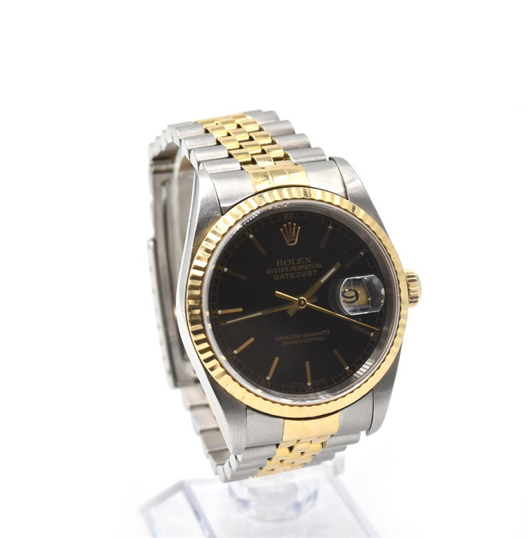 Movement: automatic Function: hours, minutes, seconds, date Case: round 36mm stainless steel case, 18k yellow gold fluted bezel, scratch resistant sapphire crystal, 18k yellow gold screw-down crown, water resistant to 100 meters Dial: black dial