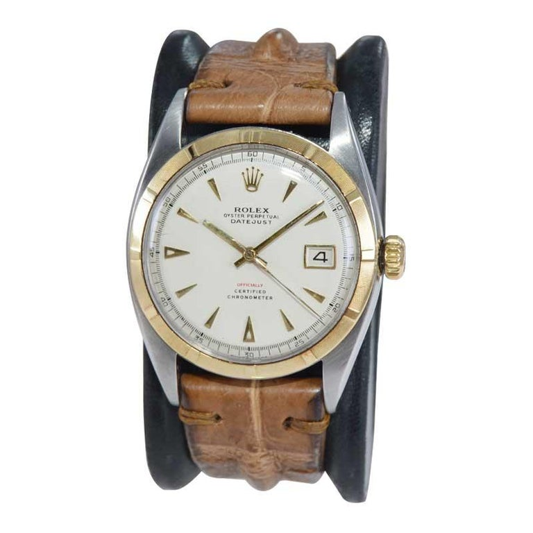 FACTORY / HOUSE: Rolex Watch Company STYLE / REFERENCE: Datejust / Ref. 6105 METAL / MATERIAL: 14Kt. Yellow Gold and Stainless Steel DIMENSIONS: 44mm X 36mm CIRCA: 1953 / 1954 MOVEMENT / CALIBER: Perpetual (Automatic) Winding / 25 Jewels / Cal.