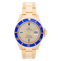 Rolex Yellow Gold Submariner Blue Bezel Champagne Dial Automatic Wristwatch