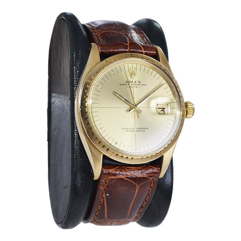 FACTORY / HOUSE: Rolex Watch Company STYLE / REFERENCE: Zephyr Notched Bezel / Ref. 15505 METAL / MATERIAL: 14Kt. Solid Yellow Gold DIMENSIONS:  42mm  X  34mm CIRCA: 1984 MOVEMENT / CALIBER: 27 Jewels / Perpetual / Cal. 3035 DIAL / HANDS: Original /