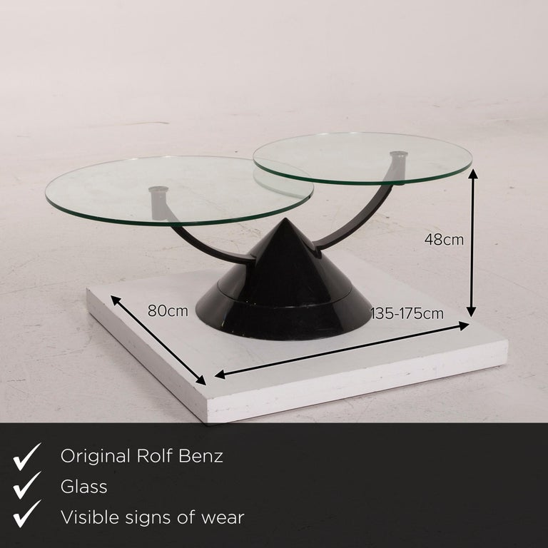 We present to you a Rolf Benz glass table black coffee table stone outlet adjustable.    Product measurements in centimeters:     Depth 80  Width 135  Height 48.