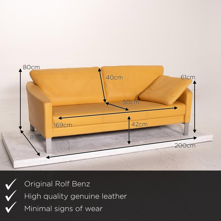 We present to you a Rolf Benz leather sofa yellow three-seat couch.  Product measurements in centimeters:  Depth 87 Width 200 Height 80 Seat height 42 Rest height 61 Seat depth 50 Seat width 169 Back height 40.