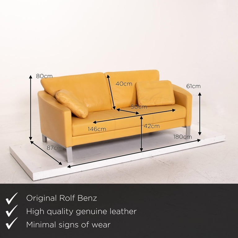 We present to you a Rolf Benz leather sofa yellow two-seat couch.       Product measurements in centimeters:    Depth 87 Width 180 Height 80 Seat height 42 Rest height 61 Seat depth 50 Seat width 146 Back height 40.