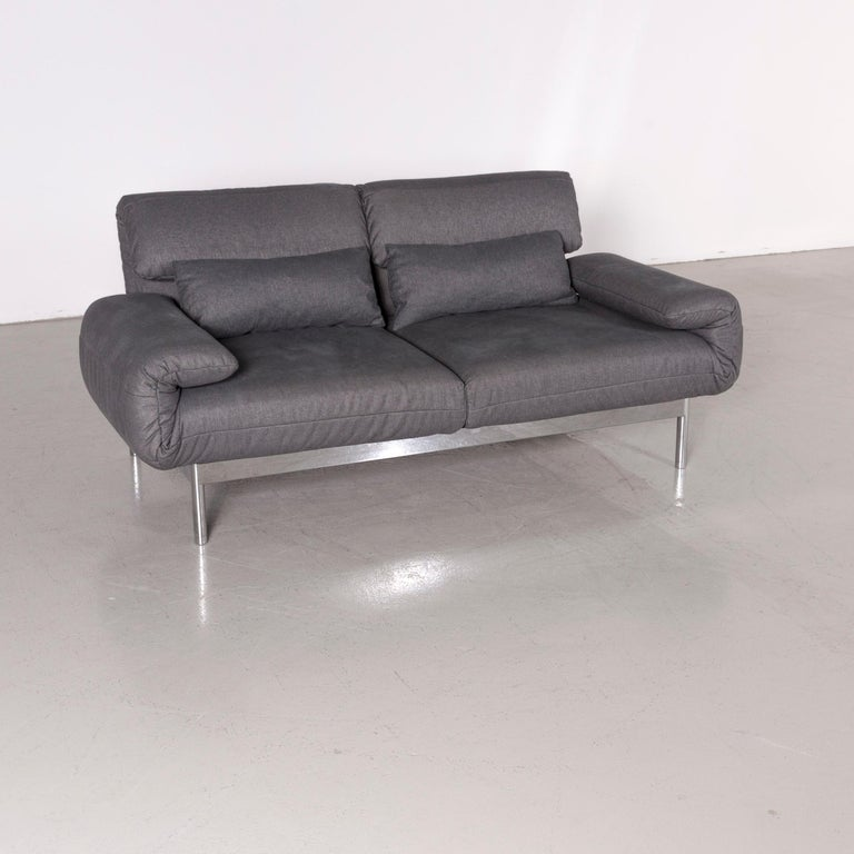 We bring to you a Rolf Benz Plura designer sofa fabric grey relax function couch modern.