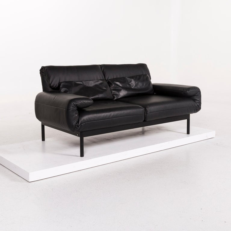 We bring to you a Rolf Benz Plura leather sofa black two-seat function relax function couch.