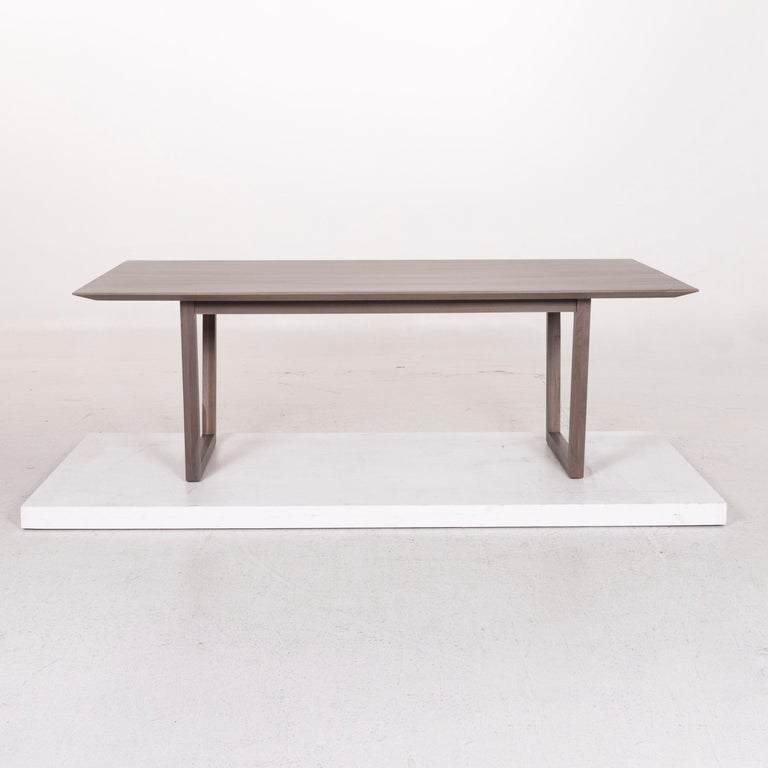 We bring to you a Rolf Benz wood dining table gray table.