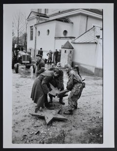 Hungary uprising  in front rebels with a broken red star, 1956.