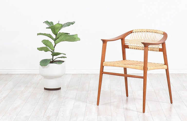 Classic modern Bambi armchair designed by Rolf Rastad and Adolf Relling for Gustav Bahus in Norway circa1950s. This iconic Bambi design is exceptionally crafted in teak wood with long and slender tapered legs and clean curved lines for a Classic