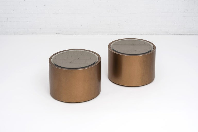 Rolling bronze drum tables with bronze tinted mirror tops, on caster wheels. Steve Chase design circa 1970s.