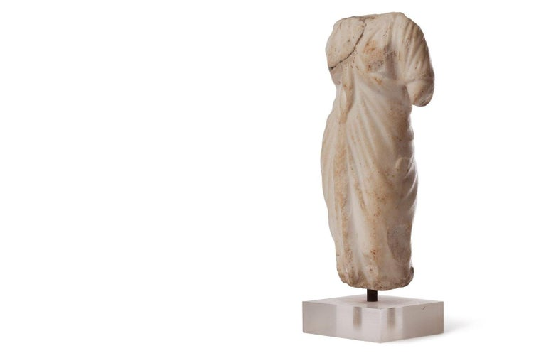 Beautiful Roman Oriental marble torso, most possibly depicting the Goddess Venus, draped with a Himation, the Greek Toga. Small defect on right shoulder.