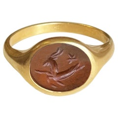 Roman Carnelian Intaglio 18 Kt Gold Ring Depicting a Capricorn and a Star