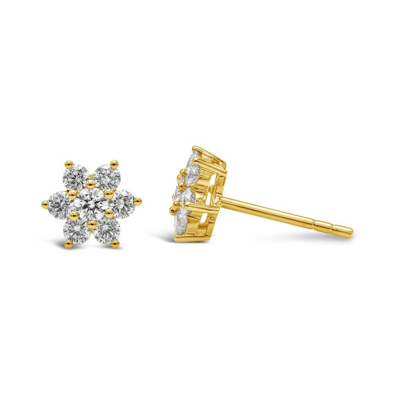 A simple and stylish pair of stud earrings featuring round brilliant diamonds, set in a floral motif made in 18k yellow gold. Diamonds weigh 0.66 carats total. A perfect everyday piece to wear.   Style available in different price ranges. Prices are