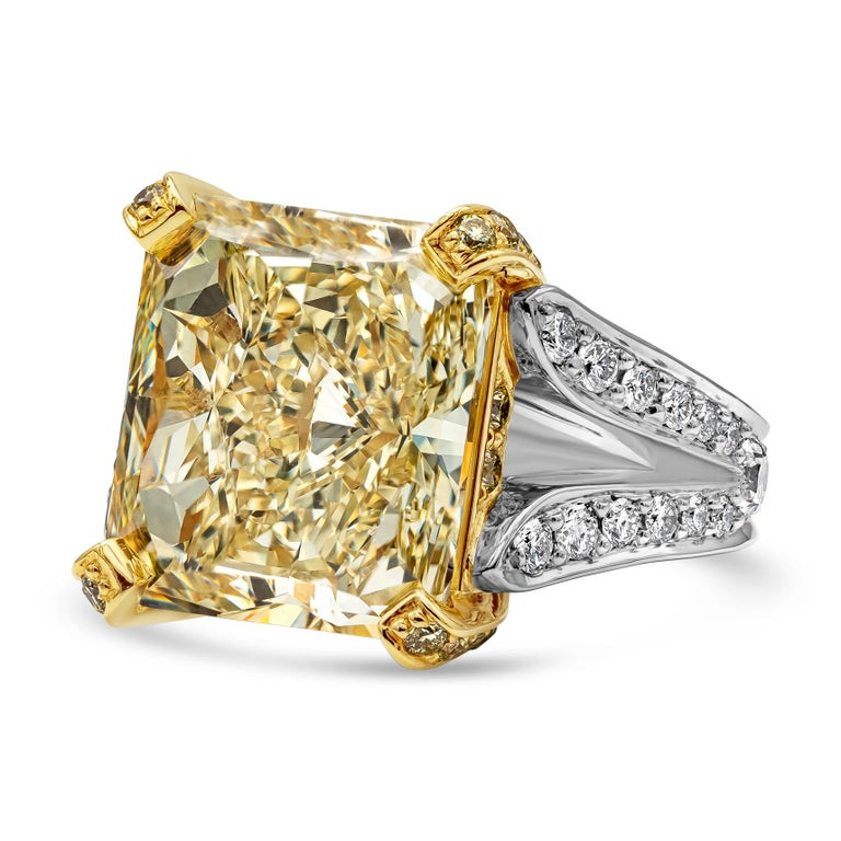 A vibrant engagement ring showcasing a 13.95 carat radiant cut yellow diamond certified by GIA as Fancy Yellow color, VS1 clarity. The center stone is set in a yellow diamond encrusted basket. Set in a platinum split-shank setting. Yellow diamonds