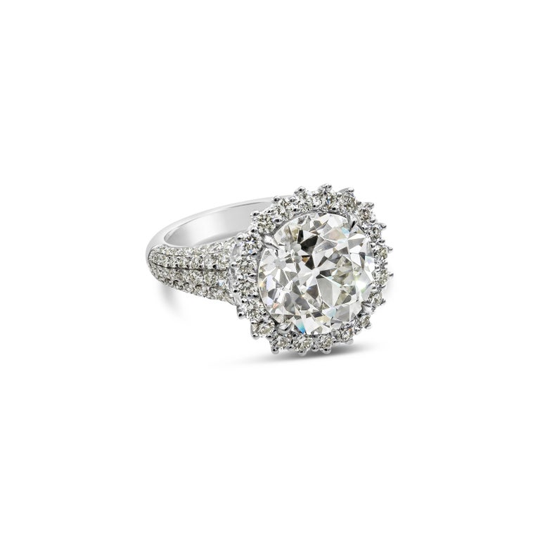 A unique and brilliant piece of jewelry featuring a 5.56 carat Old European cut diamond, surrounded by a single row of round brilliant diamonds. Set in a micro-pave diamond setting made in 18 karat white gold.  center stone L-M color VVS