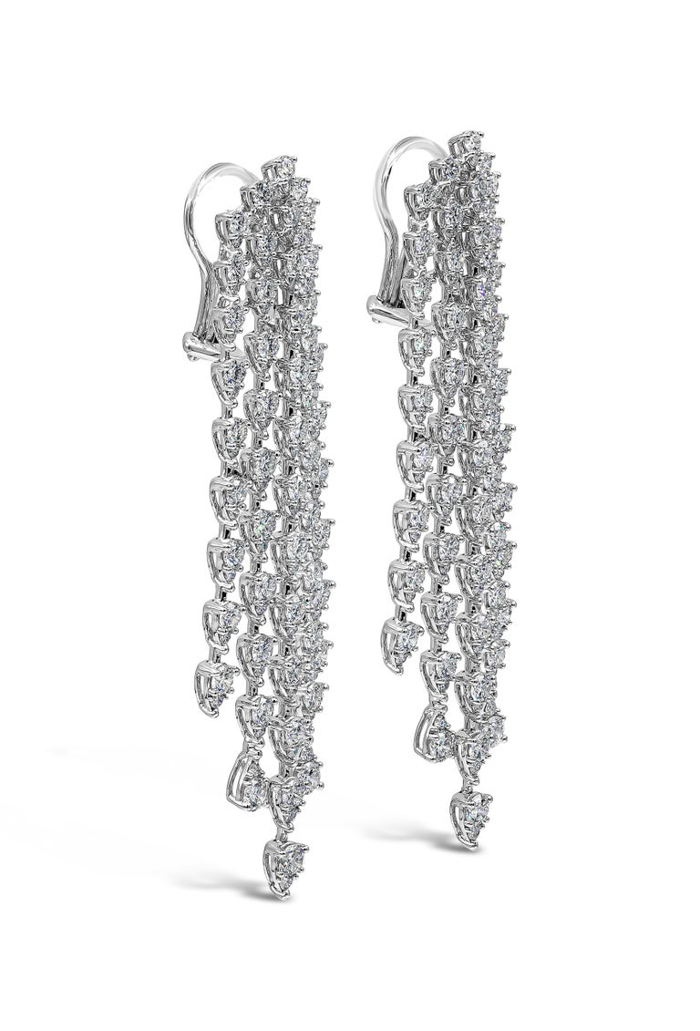 Showcasing five rows of round diamonds in a pear shaped design set in an elegant waterfall motif made in 18k white gold. Diamonds weigh 9.35 carats total and are approximately F-G color, SI clarity.   Style available in different price ranges.