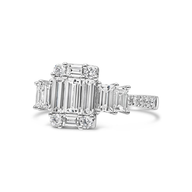 Showcasing a cluster of baguette and round diamonds, arranged like an emerald cut diamond. Flanking the center are two smaller emerald cut diamonds on either side, set in a pave setting made in 18k white gold. Size 6.5 US (sizable).  Style available