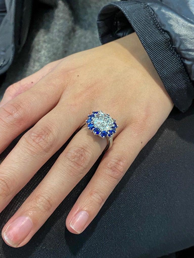 Roman Malakov GIA 7.04 Carat Cushion Cut Diamond and Blue Sapphire Halo Ring For Sale 1