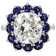 Roman Malakov GIA 7.04 Carat Cushion Cut Diamond and Blue Sapphire Halo Ring