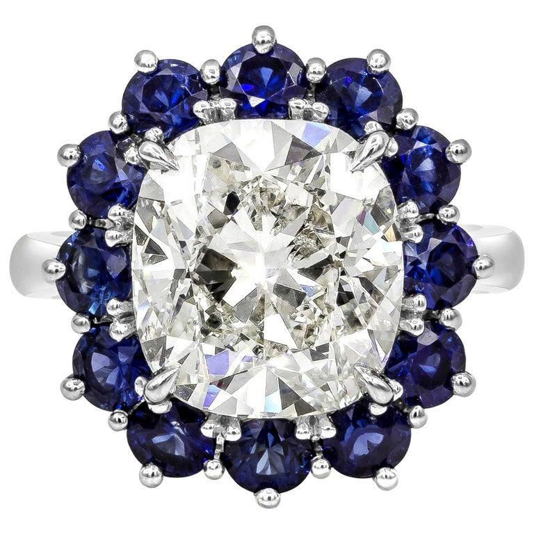 Roman Malakov GIA 7.04 Carat Cushion Cut Diamond and Blue Sapphire Halo Ring For Sale