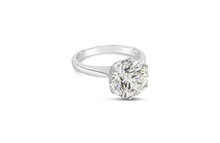 A classic six prong style engagement ring showcasing a 4.01 carat round brilliant diamond certified by GIA as L color, VS2 clarity, set in an 18 karat white gold mounting.   Style available in different price ranges. Prices are based on your