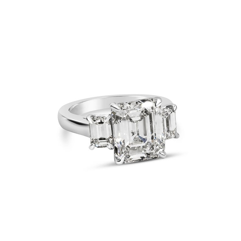 A sophisticated and subtle engagement ring style showcasing a 5.16 carat emerald cut diamond certified by GIA as H color, SI2 clarity, flanked by smaller emerald cut diamonds on each side, 1.11 carats. Made in platinum.  Total carat weight 6.27