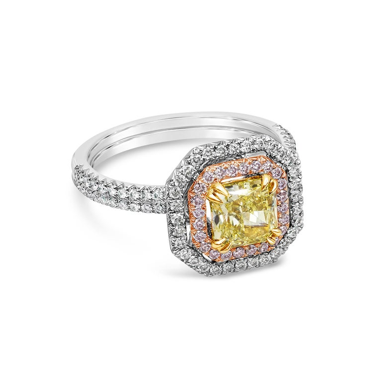 A color-rich engagement ring showcasing a 1.16 carat intense yellow diamond center diamond certified by GIA as Fancy Intense Yellow color, VS2 clarity.  Set in a floating double halo of natural pink and white diamonds. Accent diamonds weigh 0.64