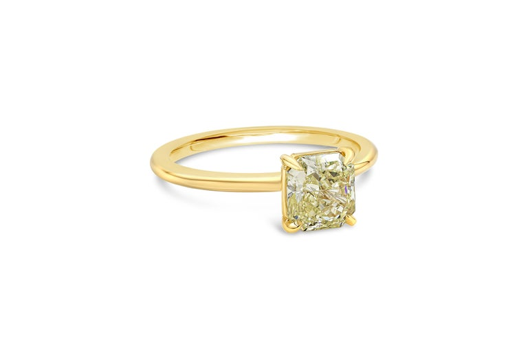 Features a color-rich 1.35 carat radiant cut yellow diamond certified by GIA as Fancy Intense Yellow color, VS2 clarity.  Set in a thin polished 18 karat yellow gold mounting. A timeless solitaire engagement ring style.  Style available in different