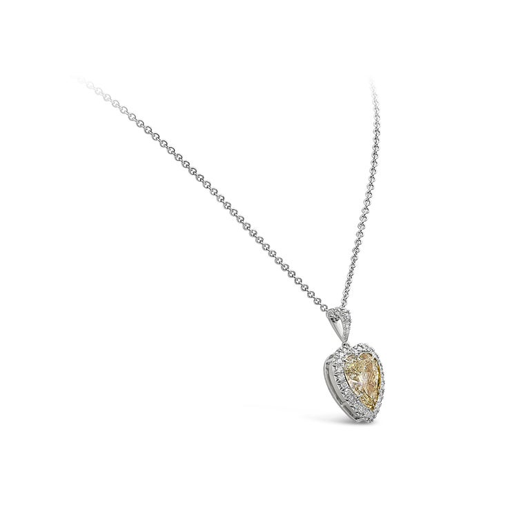 A classic pendant necklace style showcasing an 8.07 carat yellow diamond certified by GIA as Y-Z color, surrounded by a single row of round brilliant diamonds. Set in an 18k gold mounting. Suspended on a 16 inch white gold chain (adjustable upon