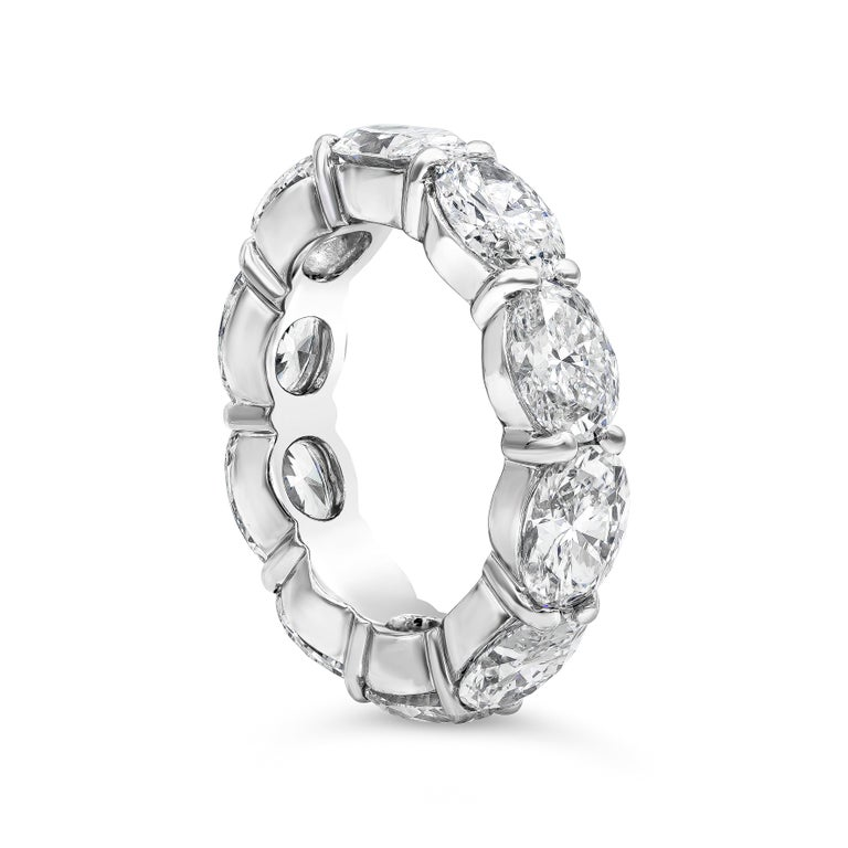 A very fashionable wedding band style showcasing a row of brilliant oval cut diamonds weighing 7.40 carats total, set in a non-traditional east-west (horizontal) design made in platinum. Size 6.5 US.  Style available in different price ranges.