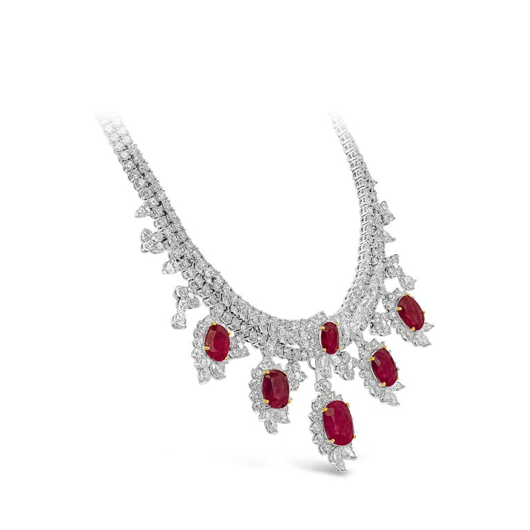 An important and very rare necklace showcasing vibrant and color-rich oval cut rubies, set in a beautiful drop design. An intricately-designed necklace accented with brilliant diamonds in a double-strand mounting. Rubies weigh 35.67 carats total;