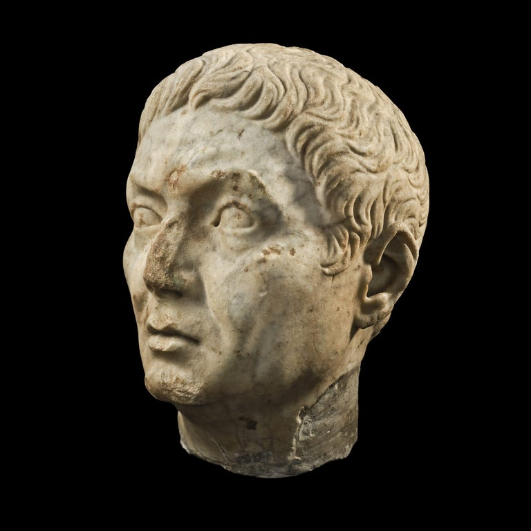 This impressive piece of Roman sculpture represents a head of a man which is, undoubtedly, a portrait. It belonged to the over life-size statue; however, it is impossible to tell if the head was carved separately and joined the figure dressed in a
