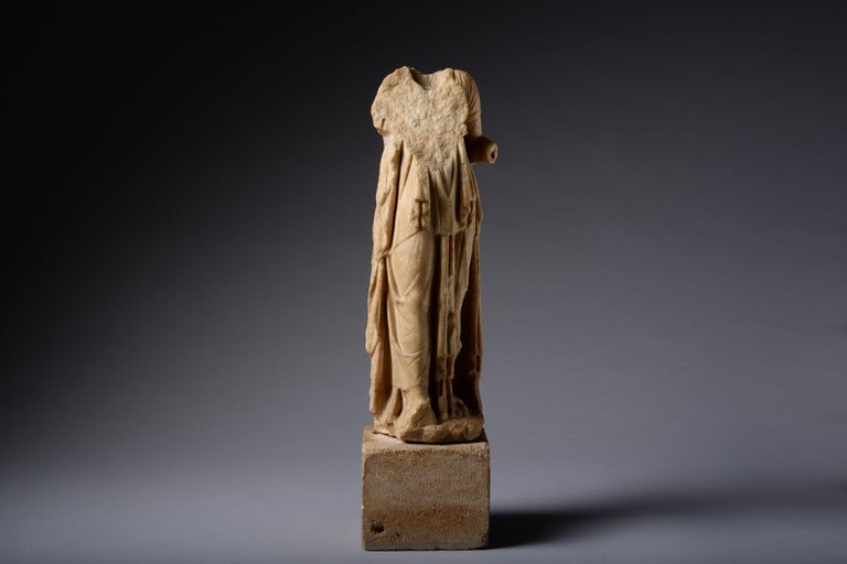 A Roman marble statue of a draped woman, circa 1st - 2nd century AD.