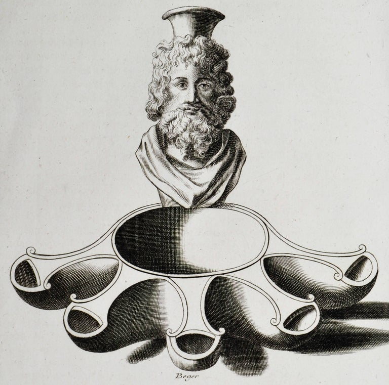 Copper engraving featuring oil lamps from the Roman Empire. From the book L'antiquite Expliquee et Representee en Figures. By the Benedisctine Monk Bernard de Montfaucon. In mat and ready to frame.