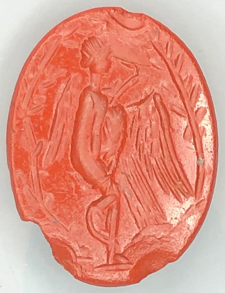 Outstanding dark red jasper intaglio depicting Leda and the swan. Roman, first century AD. The story of Leda and the swan is a popular theme in ancient art. According to Greek mythology, Zeus disguised as a swan seduces Leda, who was the wife of