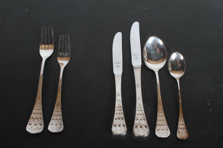 Romance by Bijorn Windblad for Rosenthal Studio-Linie Mid-Century Modern silver plate flatware for 12 with service pieces in original modernist Rosenthal Studio-Line case. The case has room to expand your set. Minor tarnish to some pieces. No longer