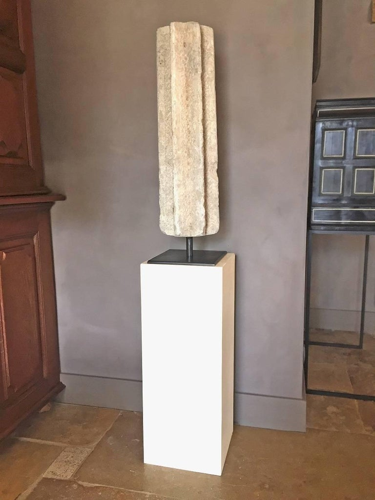 This Spanish grey sandstone column dates circa 12th-13th century. It most likely was an arch support in a cloister arcade. The peculiar shape has to been seen in the light of the centuries of Islamic influence in the Iberic world. This import of