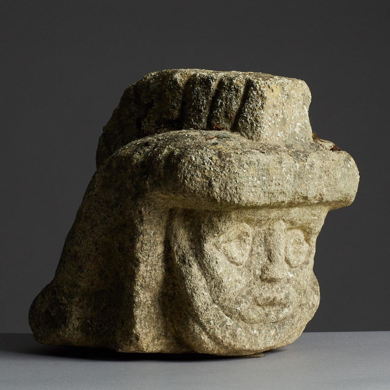 Rare Romano British / Celtic Limestone head of a Legionnaire, English, Southern England, circa, 2nd-3rd century.  The Oolitic Limestone carved stylised head of a Legionnaire wearing a Galea surmounted with a plumed crest, having deep set eyes and