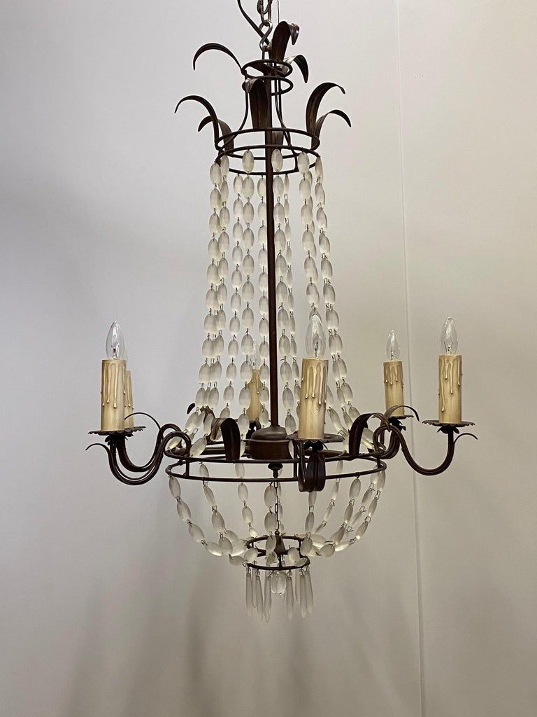 Romantic Empire style iron and frosted glass chandelier having delicate draping necklaces of glass and 6 arms.