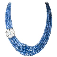 Romantic Necklace in Sapphire with a Flower Scrap, Gold, Diamonds and Akoya Pea