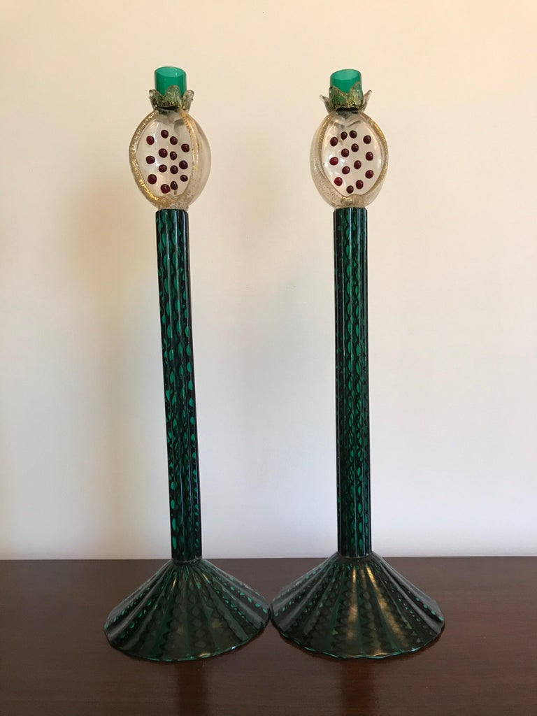 A rare and wonderful pair of art glass candle holders designed by fashion designer Romeo Gigli for Pauly&Co Compagnia di Venezia e Murano.  Only a very few of these were made and or exist.   Long stemmed hand blown glass with gold inclusions and