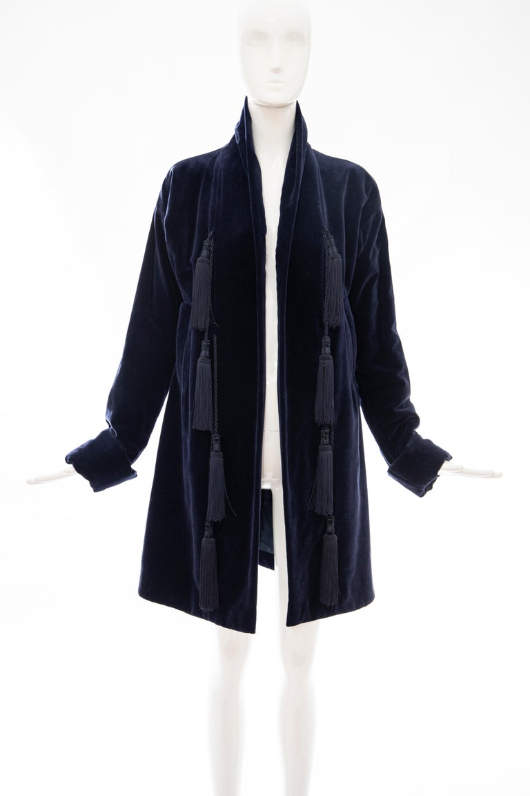Romeo Gigli, Fall 1994 navy blue cotton velvet Kimono jacket with appliquéd tassels, two front inset pockets, Kimono gusset cuffed sleeve, back vent and fully lined.  FR. 44  Bust: 35, Waist: 33, Hips: 43, Sleeve: 24, Shoulder: 21, Length: 36