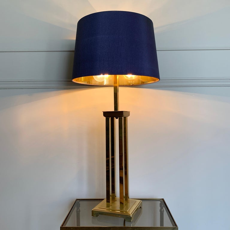 Romeo Rega attributed Cubist brass table lamp, 1970s Italy A heavy good quality lamp made from solid metal, brass-plated Replacement modern shade in graphite grey with metallic gold inner 78cm height, base 15cm, shade width 35cm 2 bulb holders