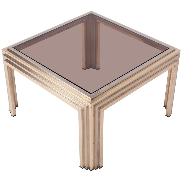 Brass and chrome eclectic coffee table by Romeo Rega In the Hollywood Regency style of Maison Charles / Jansen Italian glam from the 1970s Smoked glass top.