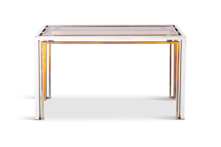 Hollywood regency mid-century modern console table by Italian designer Rome Rega, Italy, 1970s  The sculptural chrome and brass frame is contrasting nicely with the smoked glass top which is held in place with purple perspex details  Eclectic